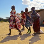 Women from the village of Kerio drag sacks of food aid, provided by the United States Agency for International Development (USAID), across the Kenyan desert. USAID, responsible for foreign, civilian aid, was created from an executive order by President John F. Kennedy in 1961. (Jessica Stallone)