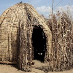 The building material and square shape of this hut in Loreng'elup makes it untraditional. The mud is made from a clay and water mixture that adds more stability to the structure than the more traditional reed buildings. (Rebecca Anzel)