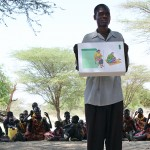 Peter Emkui, a community health worker in the village of Koono, educates malnurished women and children on good health practices. (Lindsey Campbell)