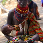 Joyce Agis Ekai waits for Merlin aid workers to set up a malnutrition clinic with her daughter, Lokwawi Turkei, Koono. (Lindsey Campbell)