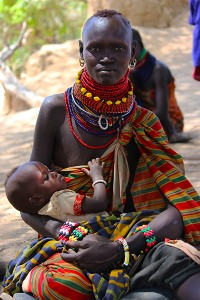 Joyce Agis Ekai waits for Merlin aid workers to set up a malnutrition clinic with her daughter, Lokwawi Turkei, Koono, Turkana, Kenya, Jan. 18, 2013. (Lindsey Campbell)