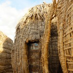 The door is constructed of U.S. AID boxes in the hut of the local seer, or traditional witch doctor, Lokipetota-Akwan. (Jessica Stallone)