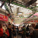 People mill around Gwangjang Market, a traditional street market located in Jongno-gu, Seoul, South Korea on July 1, 2016. It opened in 1905 and remains the oldest traditional market in Korea. Photo by Taylor Ha.