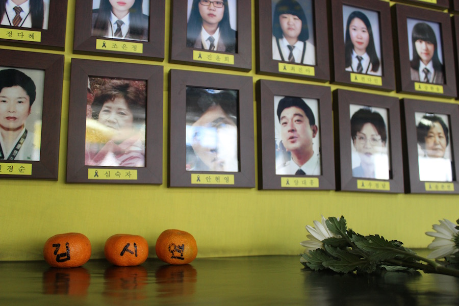 Photos that are part of a memorial for the Sewol Ferry victims, including students and teachers. Photo by Taylor Ha.