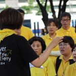 Families of the Sewol Ferry victims sing together at the demonstration by Gwanghwamun Square. Photo by Taylor Ha.