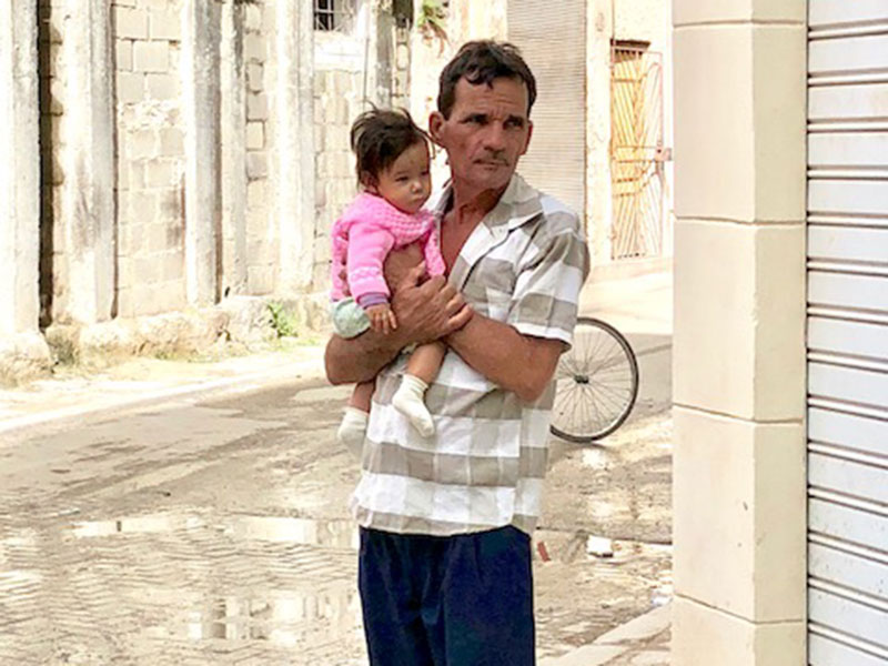 """Cuba deals with the legacy of """"pies secos, pies mojados"""""""